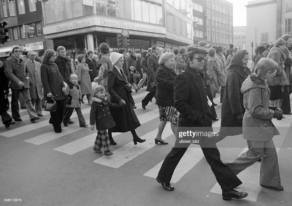 people on shopping expedition, shopping street, pedestrian zone, zebra crossing, D-Essen, Ruhr area, North Rhine-Westphalia - 20.12.1975 : News Photo