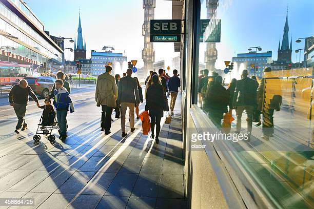 people on sidewalk in sunset - sweden stock pictures, royalty-free photos & images