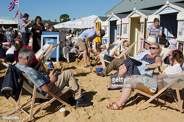 People on sitting in deck chairs on the Beach Area at Goodwood on September 11 2016 in Chichester England