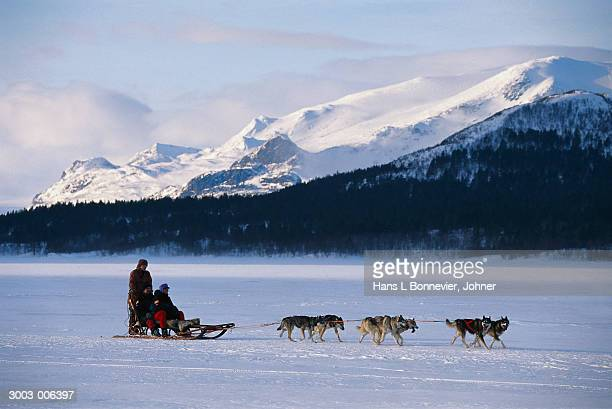 People on Sleigh by Mountain