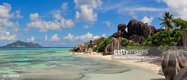 people on source d'argent beach in the seychelles - la digue island stock pictures, royalty-free photos & images