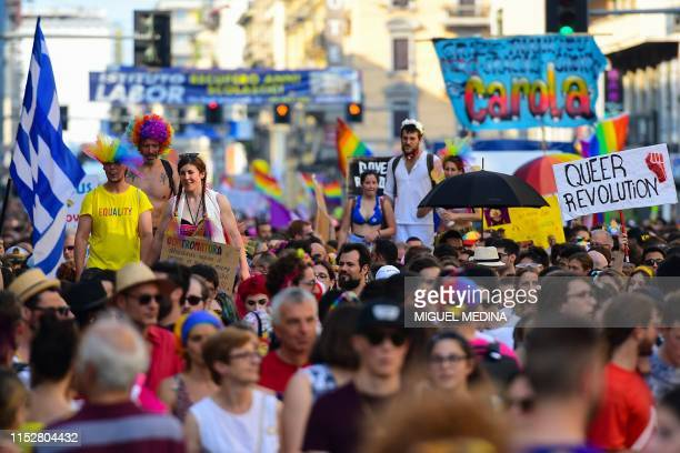 People on stilts parade during the Milan Pride 2019 on June 29 2019 in Milan as part of the LGBT Pride month marking the 50th anniversary of the New...