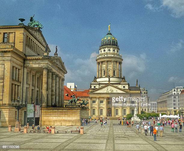 people on street against neue kirche at gendarmenmarkt in city - kirche stock pictures, royalty-free photos & images