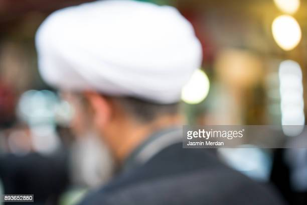 people on street, blurred man - iranian culture stock photos and pictures