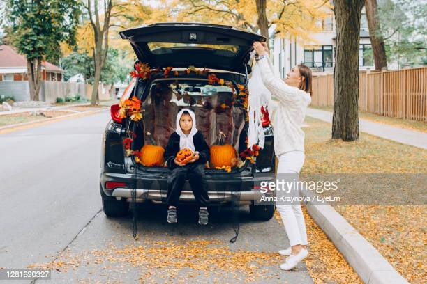 people on street in city - car decoration stock pictures, royalty-free photos & images
