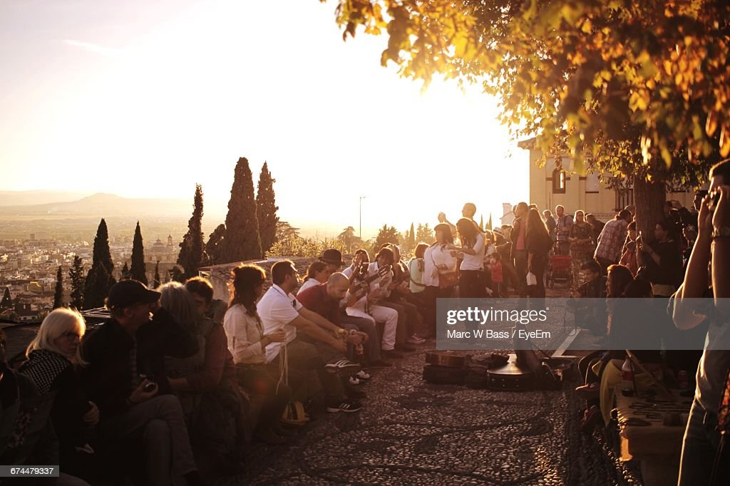 People On Street In Granada Against Sky During Sunset : Stock Photo