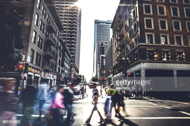 people on street of downtown san fransisco - san francisco california stock photos and pictures