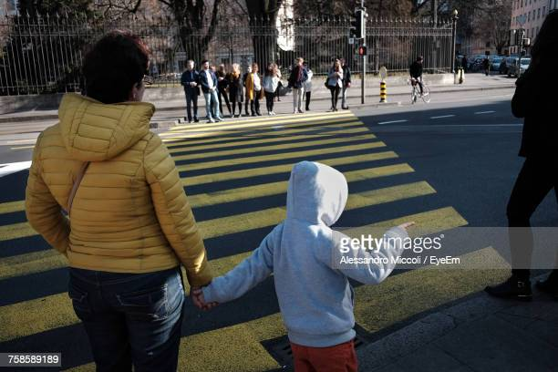 people on street - alessandro miccoli stockfoto's en -beelden