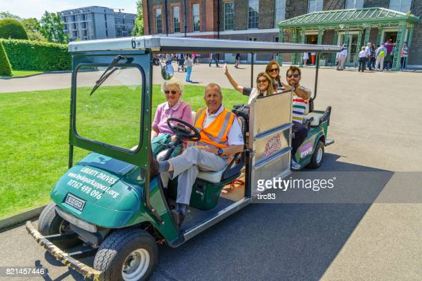 People on stretched golf buggy
