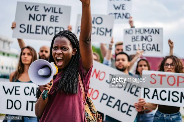people on strike against racism - protest against violence against women stock pictures, royalty-free photos & images