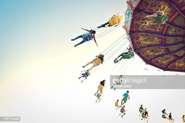 people on swing ride - high up stock pictures, royalty-free photos & images