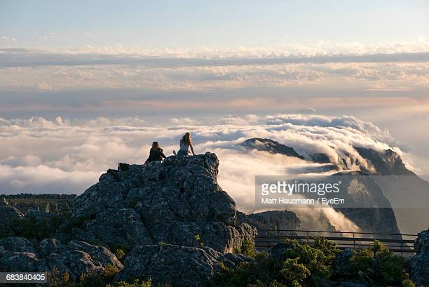 people on table mountain against cloudscape - table mountain stock pictures, royalty-free photos & images