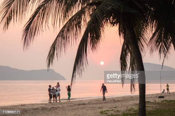 people on thai beach at sunrise - hua hin thailand stock pictures, royalty-free photos & images