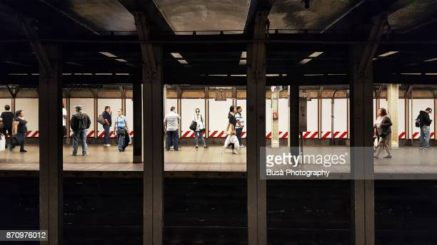 People on the 57th Street subway platform. Manhattan, New York City