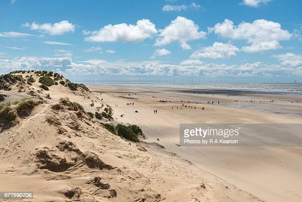 people on the beach at formby point, merseyside, england - merseyside stock pictures, royalty-free photos & images