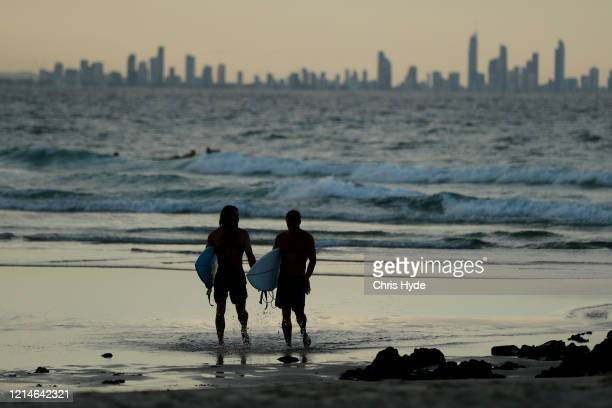 People on the beach at Snapper Rocks which is on the Queensland and New South Wales border at Coolangatta on March 25 2020 in Gold Coast Australia...