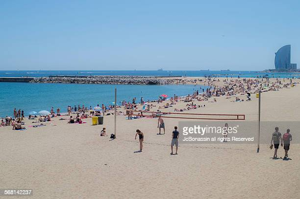 people on the beach barcelona spain - jcbonassin stock pictures, royalty-free photos & images