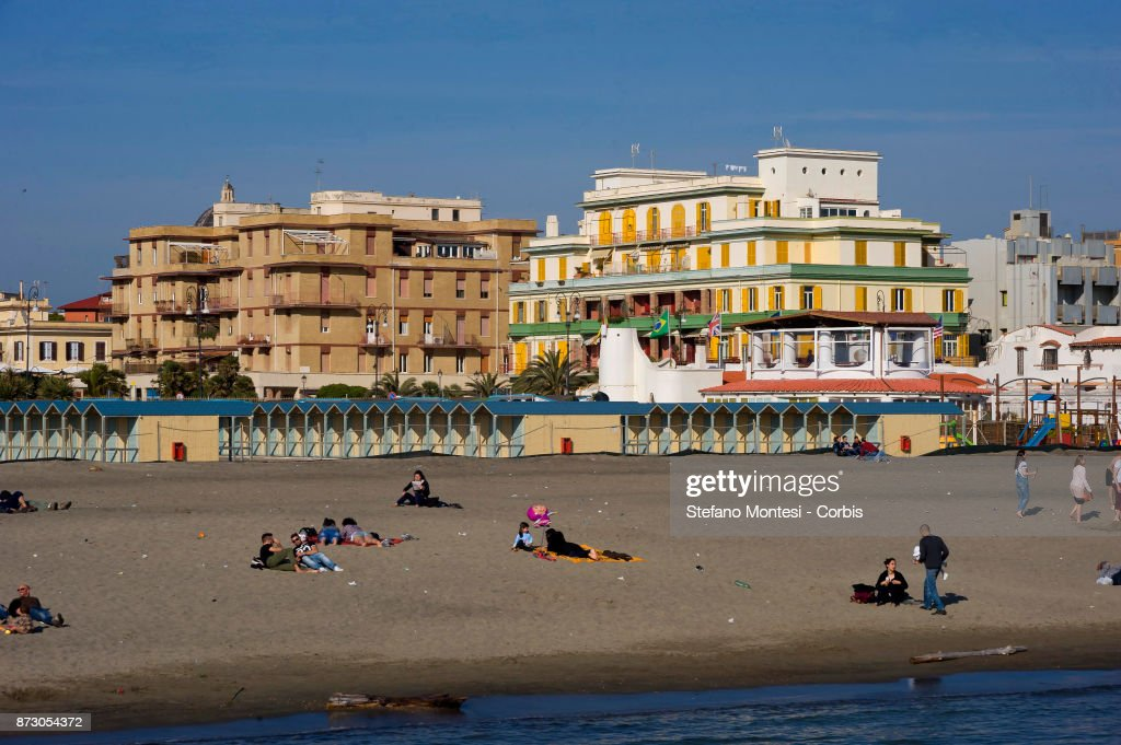 people on the beach for the first days of spring sunshine at ostia