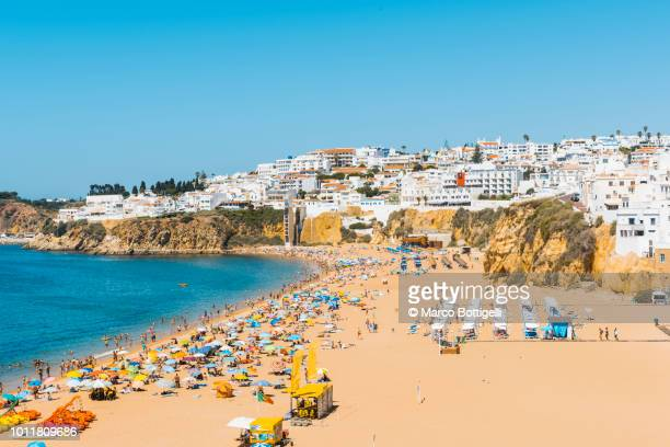 people on the beach in summer, algarve, portugal - albufeira stock pictures, royalty-free photos & images