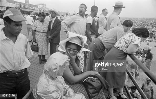 People on the boardwalk at Coney Island New York City circa 1952