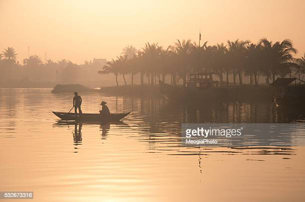 People on the boat in early morning in Hoian, Vietnam