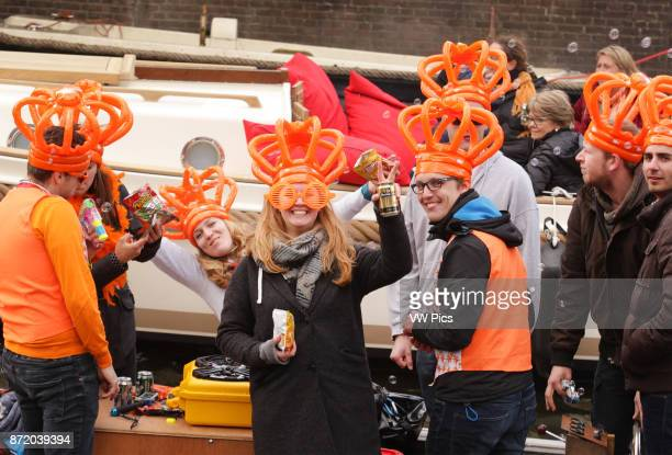 People on the boats at Prinsengracht canal celebrate King's Day in AmsterdamNetherlands on April 27 2017 The King's day marking the birth of King...