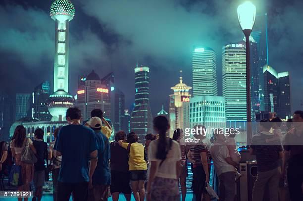 People on the bund overlooks Oriental Pearl Tower