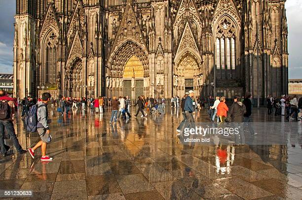 People On The Cathedral Record After A Thunderstorm Shower Before Main Entrance Of