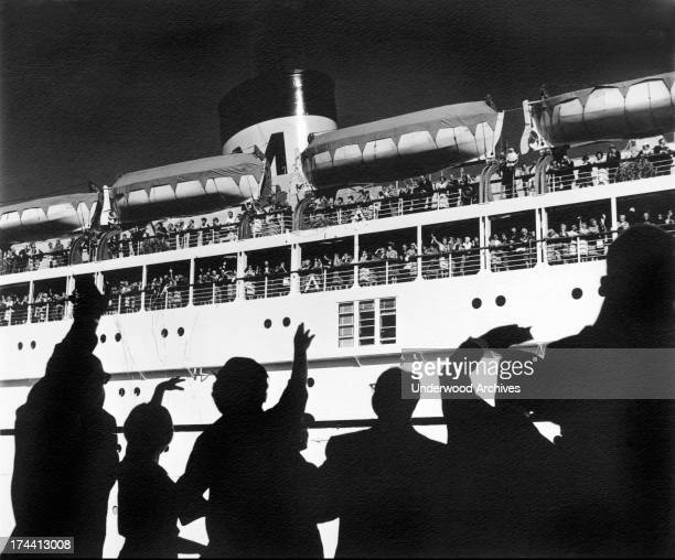 People on the docks wave 'bon voyage' to friends and family departing on a Matson Liner San Francisco California 1955