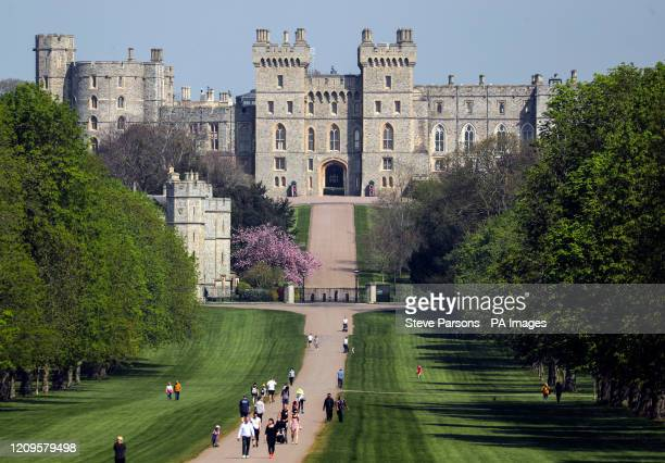 People on the Long Walk at Windsor Castle, Berkshire, during the Easter bank holiday weekend, as the UK continues in lockdown to help curb the spread...