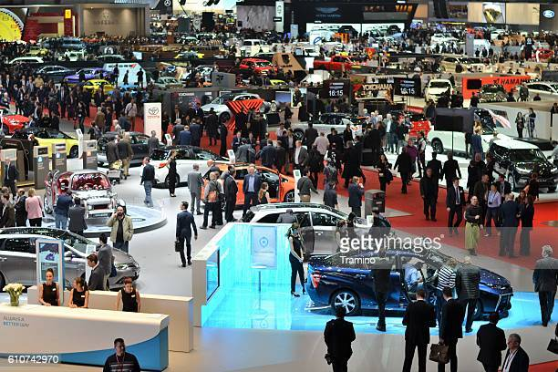people on the motor show - geneva international motor show stock pictures, royalty-free photos & images