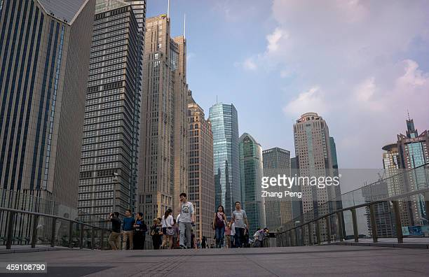 People on the overpass bridge at the center of Lujiazui financial and trade zone On Nov 17 the ShanghaiHong Kong Stock Connect is set to officially...