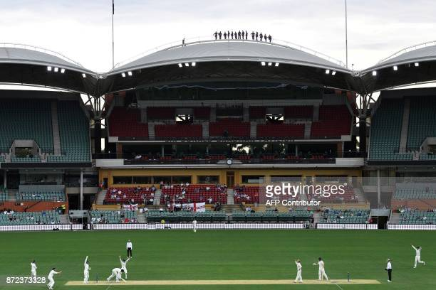 People on the roof of the Adelaide Oval watch the third day of a fourday Ashes tour match between Cricket Australia XI and England in Adelaide on...
