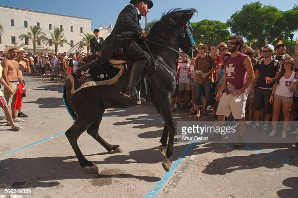 People on the Sant Joan celebration in Ciutadella de Menorca during the summer solstice