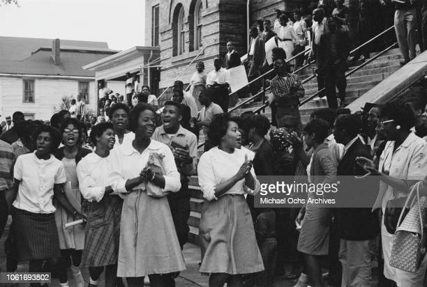 People on the steps of the 16th Street Baptist Church headquarters of the Birmingham Campaign in Birmingham Alabama May 1963 The movement which...