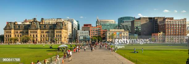 people on the steps of the parliament building in ottawa, canada - ottawa stock pictures, royalty-free photos & images