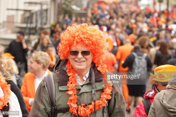 People on the stree at Prinsengracht canal celebrate King's Day in AmsterdamNetherlands on April 27 2017 The King's day marking the birth of King...