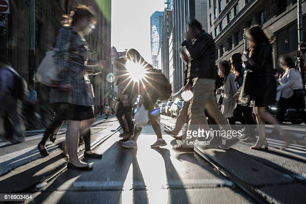 people on the street crossing in toronto, canada - affollato foto e immagini stock