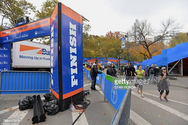 People on the street near the finish line of the New York City Marathon October 31 2013 in New York as preparations continue for the November 3 race...