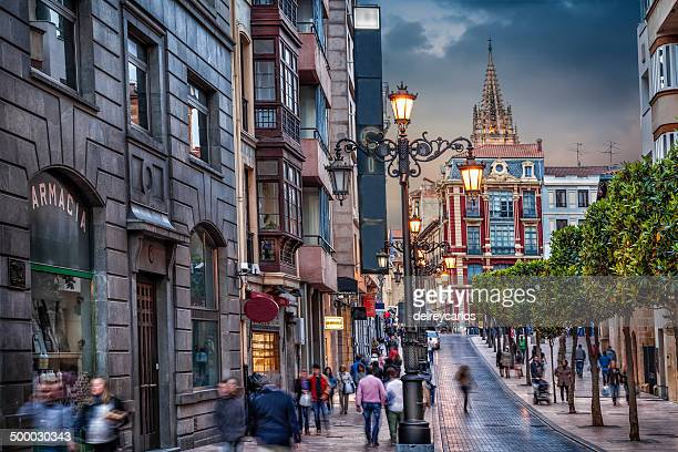 people on the streets at dusk - oviedo stock pictures, royalty-free photos & images