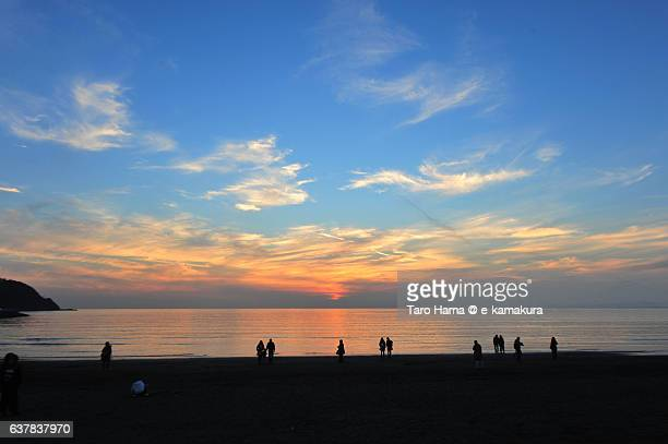 People on the sunset beach