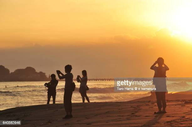 People on the sunset beach