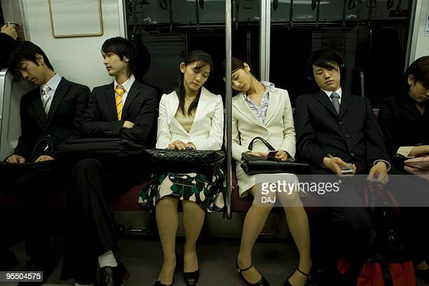 People on the train, sleeping on the seat