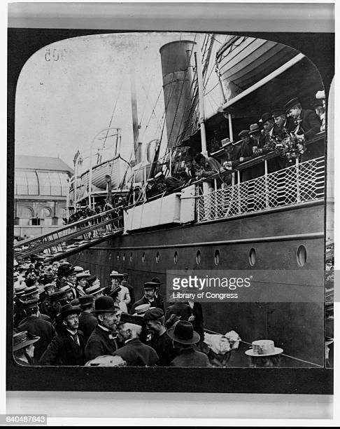People on the wharf in Christiana Norway wave goodbye to passengers on the SS Angelo part of the Wilson Line They are emigrating to the USA ca 1905 |...