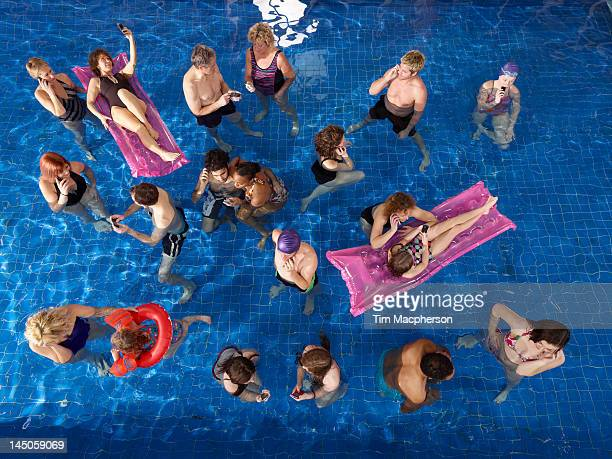 People on their mobile phones in Pool
