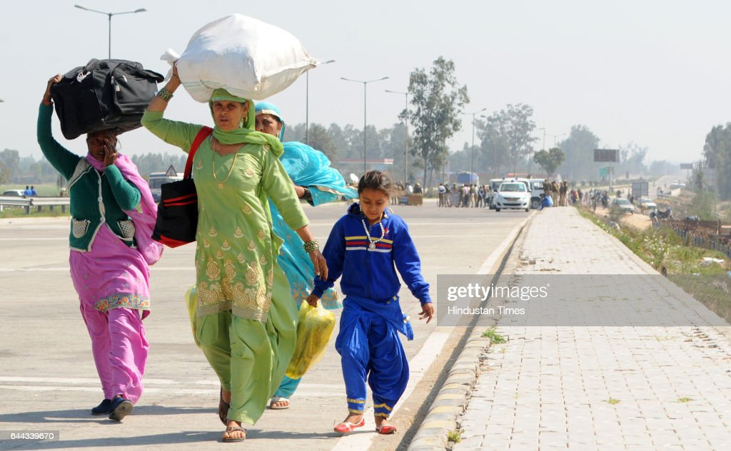 People on their way by foot after National Highway closed due to tension mounted between Punjab and Haryana over the SatlujYamuna Link canal issue in.