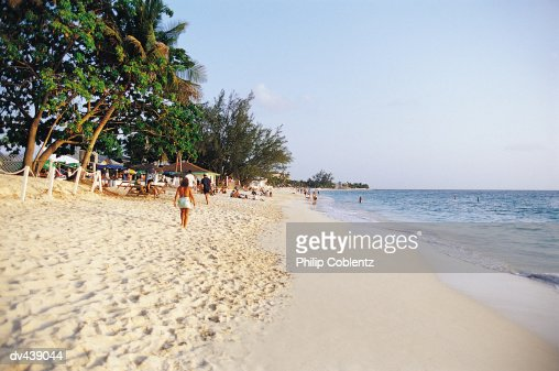 Boats And People On Tropical Island Beach Stock Photo