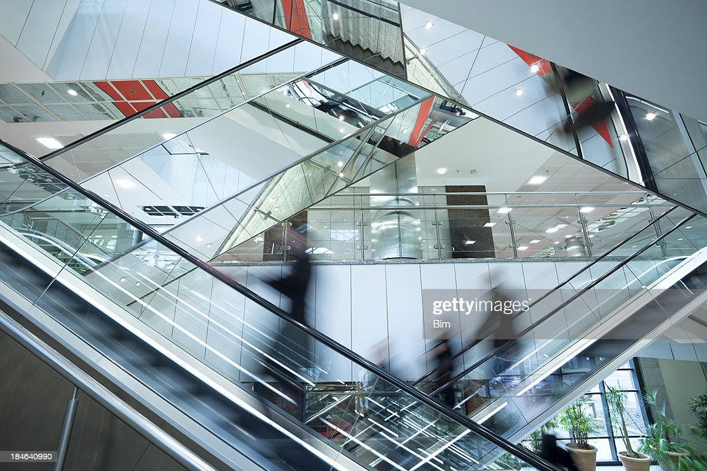 People on Two Crossed Escalators, Blurred Motion : Stock Photo