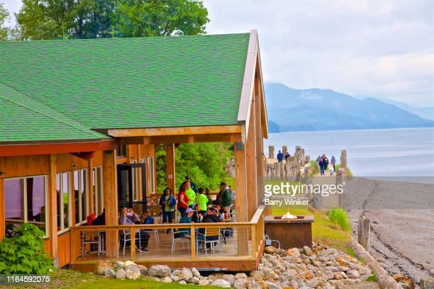 people on walkway and dining on porch at icy strait point, alaska - barry wood stock pictures, royalty-free photos & images