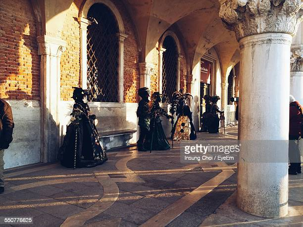 people on walkway during venice carnival - venice carnival stock pictures, royalty-free photos & images